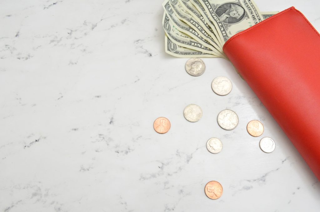 wallet with cash- frugal living tips for moms in 2020