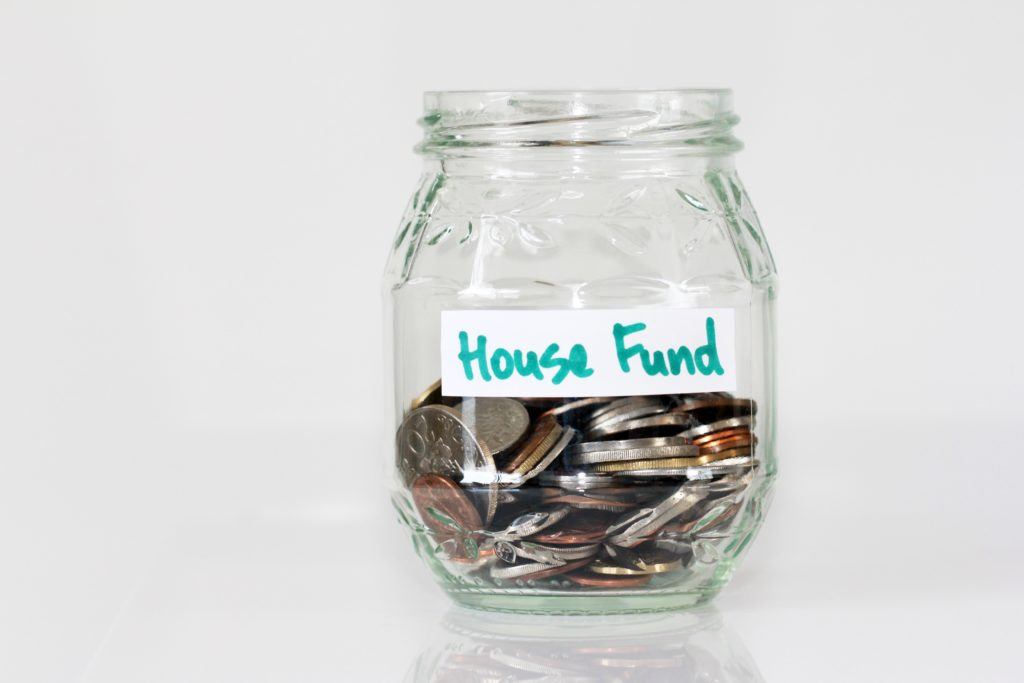 bottle with house fund on it - frugal living tips for moms in 2020