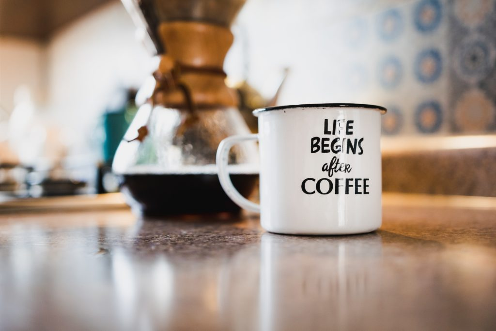 a coffee mug with a coffee maker - frugal living tips for moms in 2020